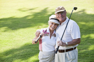 Senior couple playing golf